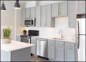 Kitchen with gray cabinets and white subway tile backsplash